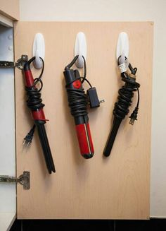 Use Command hooks inside bathroom cabinets to hang flat irons, curling irons etc.