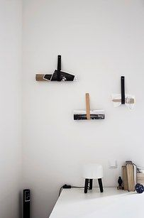 A strip of leather nailed into the wall becomes a cool, minimalist way to hold your stuff. | The 52 Easiest And Quickest DIY Projects Of All Time