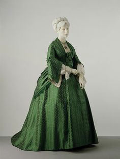 Dress, Place of origin: England, Date: ca. 1872 (made) Silk, trimmed with silk braid, lined with glazed cotton, buckram and silk ribbon, and boned Museum number: T.101 to B-1972 V