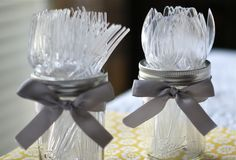 utensils displayed in mason jars. oh the things you can do with glass ware!