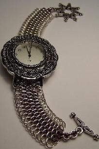This is a watchface with a Dragonscale weave chainmail band.  Finished with a large star shaped silver toggle clasp  This watch band is completly hand made. It starts as wire, it is coiled, cut and assembled in the weave by hand.