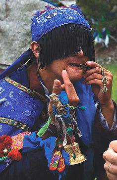 Mongolian white shaman, playing a jaw harp and holding a bell. White shamans get their power from the white Western direction. Because of this, they direct their prayers to the Western Heavens. White shamans are shamans of peace and have a special relationship with the spirits of nature. Their main focus is on pacifying angry spirits and helping mankind to live in balance with nature. White shamans also do divination and blessings. One thing that they can not do is a shaman's curse.