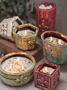 Filled Pottery Candles...Swan Creek Candle Co. http://www.swancreekcandle.com/ .