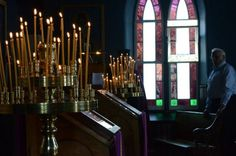 Candelia / Lampadas. Traditional Orthodox services are lead with beeswax candles burning at the stands.  (2013stjoseph)