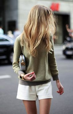 White shorts, olive sweater and golden details.