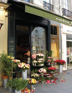 Quaint Paris flower shop. I like the black and green colour scheme.