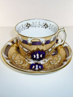 This is an antique English porcelain cup and saucer in gold and blue. The set dates to about Note the delicate gold vine design inside the cup. The bottom of cup is marked with number 2022 in gold, but there is no maker's mark. Tea Cup Set, My Cup Of Tea, Cup And Saucer Set, Tea Cup Saucer, Tea Sets, China Cups And Saucers, Teapots And Cups, Cup And Saucer Crafts, Cute Tea Cups