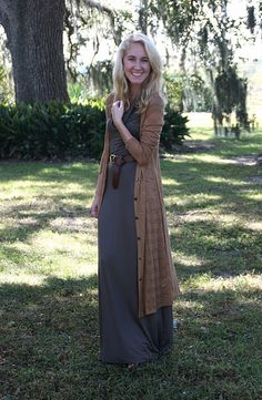 Grey maxi dress, long tan cardigan, brown belt - all that is missing is a hijab. Add that and it'll be perfect.