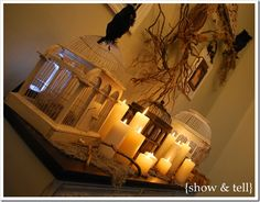 I like this idea of gathering diff size cages with candles all around
