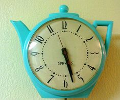 Such a cute vintage turquoise blue teapot kitchen clock
