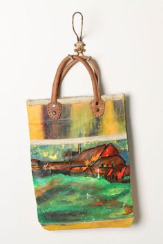 This is an anthro bag made out of an original oil painting, what a brilliant idea for thrift store paintings!  line with a canvas, I wonder if you would need to use a gel medium on the face of the bag or not hmmm.