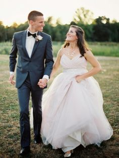 bride and groom blush wedding gown