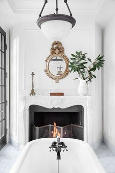 French inspired bathroom with freestanding tub and fireplace