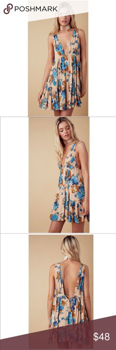 """April Floral Parade Dress  April Floral Parade Dress  A head-turning floral dress featuring floral print, plunging neckline and drawstring closure at back. 100% Rayon. Color: Maize  * Measures approx. 32"""" long, 30"""" chest, 28"""" waist * 100% rayon * Hand wash cold * Model is in size S * Model is 5' 7"""", 30"""" bust, 28"""" waist, 35"""" hips beeloveboutique Dresses"""