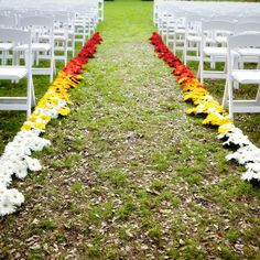 Colorful Daisy-Lined Ceremony Aisle // Ashley Garmon Photographers // Flowers: Cherry Lane Floral Design //  http://www.theknot.com/weddings/album/a-bright-fiesta-inspired-wedding-in-austin-tx-138896
