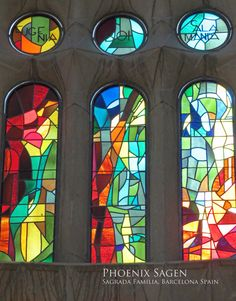 The multi-colored stained glass windows inside the Sagrada Familia, Barcelona Spain by Phoenix Sagen