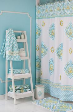 Pretty bathroom in turquoise, yellow, and white.