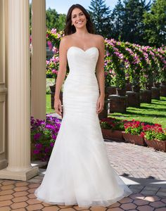 Sincerity wedding dress style 3915 A sweetheart neckline adorns this fit and flare draped organza gown with a chapel length train to create a classic and understated wedding day look. Accessorize this gown with our pop in lace cap sleeves, available as style 3915PI.