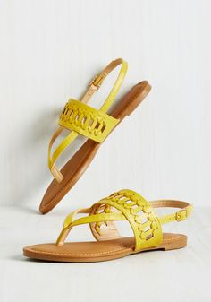 Take the boardwalk by storm by skipping straight to your favorite haunt in these fun yellow sandals! These faux-leather thongs tout V-shaped toes and cutout straps with woven accents that assure you look as cool as your tropical bevvie tastes. Cute Sandals, Shoes Sandals, Flat Sandals, Flats, Heels, Sock Shoes, Shoe Boots, Yellow Sandals, Cinderella Shoes