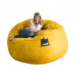 Round Yellow Foam Beanbag Chair Huge SLACKER sack Microsuede Cover Lemon XL by SLACKER sack, Like other parents who purchased this type of bag, I never really got to sit on it for an extended amount of time. It's dominated by the little one who adds a feather comforter and tries to negotiate sleeping the night in it. It's very large and it did come with the pouch. It was fun to separate the foam pieces and watch it expand for the first few days.