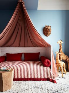 This Leading Designer's NYC Home Is a Wellspring of Inspirat.-This Leading Designer's NYC Home Is a Wellspring of Inspiration a striped, tented bed in a room with blue walls and a large stuffed giraffe - Girl Room, Girls Bedroom, Bedroom Decor, Bedroom Ideas, Bedroom Lighting, Baby Room, Child's Room, Bedroom Designs, Modern Bedroom