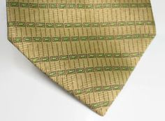 Classic Men Necktie FAUSTINO    Classic Style Cravat    Made in china  Type : large  Color : Brown with green dots  100% Polyester  Quantity : 1 Pc