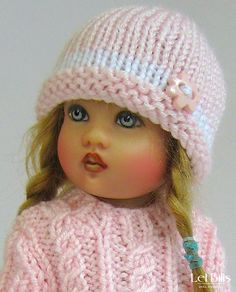 Cabled sweater and button trimmed hat for Kish Riley by Lel Bills