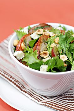 Autumn harvest salad: fennel-roasted apples, grapes, blue cheese and toasted hazelnuts