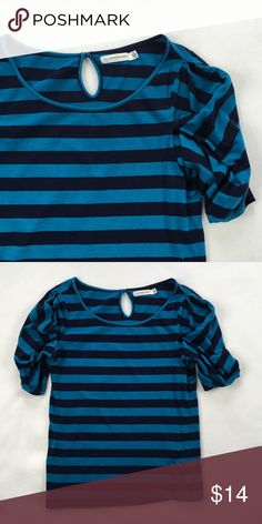 """Pilcro / Anthropologie Striped Bubble Sleeve Tee Adorable t-shirt by Pilcro from Anthropologie. Blue on blue stripes and keyhole and button closure at back of neck.  Sleeves are a unique folded and puffed design.  A very wearable design, but definitely not your basic tee.  In gently used condition.  No stains or holes.  Flat lay measurements: length 23"""", width across underarms 17"""". Anthropologie Tops Tees - Short Sleeve"""