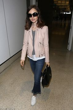 Leaving town: Lily Collins, 28, looked nice as she was snapped at LAX airport on Saturday getting ready to board a departing flight