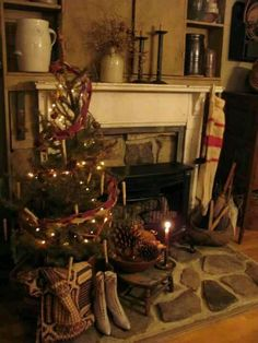 Wonderful...rustic country primitive holiday mantel display!!! Bebe'!!! Really has a New England look about it!!!