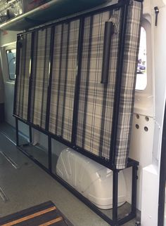 Our Original Flatout bed. Turns a work van into a comfortable camper in seconds.