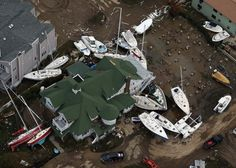 SEA BRIGHT, NJ - OCTOBER 31: Boats are strewn among buildings amid wreckage from Superstorm Sandy on October 31, 2012 in Sea Bright, New Jersey. At least 50 people were reportedly killed in the U.S. by Sandy with New Jersey suffering massive damage and power outages. Photo: Mario Tama, Getty Images / 2012 Getty Images