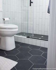 Black and White bathroom | Modern Farmhouse | black and white tile | Start at Home Downstairs Bathroom, White Bathroom, Modern Bathroom, Bathroom Stuff, Master Bathroom, Black And White Flooring, Black And White Tiles, Shower Sliding Glass Door, Quarter Sawn White Oak