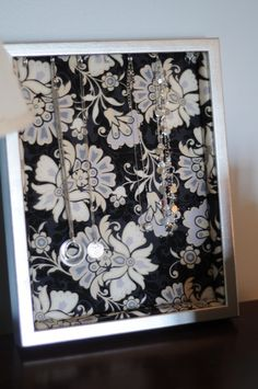 Jewelry Shadowbox with fabric backing. You could hang several on your wall for decoration & function!
