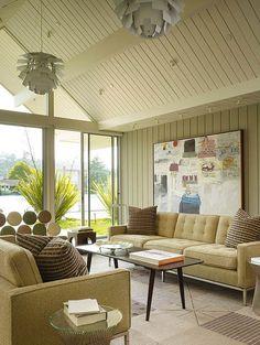 Sala de estar recupera a glória do design 60s.