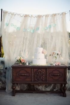 backdrop! cake tables on antique furniture:) perfect!