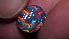 Amazing video of a stunning Black Opal with striped multicolor fire #Gemstones #Opal #BlackOpal