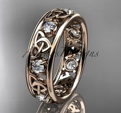 rose gold celtic trinity knot wedding band, engagement ring It has 7 genuine white saphires total weight of . The width of the ring is and the thickness is All sizes are available This ring would make excellent engagement ring or a very special present Celtic Rings, Celtic Wedding Rings, Titanium Wedding Rings, Unique Diamond Engagement Rings, Engagement Wedding Ring Sets, Wedding Bands, Celtic Engagement Rings, Solitaire Engagement, Wedding Venues