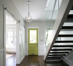 Contemporary Entry by Feldman Architecture, Inc.In a sleek, modern entryway a chartreuse door draws the eye.  Door color: C2 paint in Al Green