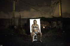 Andrea, better known as Loira, which is the Portuguese word for 'blonde,' poses for a portrait in an open-air crack cocaine market. Andrea says she is married and has a home, but she keeps returning to Crackland to feed her addiction