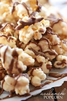 Make this fun treat with popcorn from Lisa's Passion for Popcorn Avalanche Popcorn. this popcorn is SO addicting. Which chocolate, peanut butter, marshmallows, crispy cereal and drizzled in milk chocolate- it is heavenly! Gourmet Popcorn, Popcorn Recipes, Candy Recipes, Sweet Recipes, Snack Recipes, Dessert Recipes, Popcorn Snacks, Popcorn Balls, Pop Popcorn