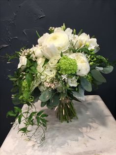 Beautiful Bridal bouquet with peonies, white tulips, ranunculus, lisianthus, veronica, jasmines, viburnum and eucalyptus.