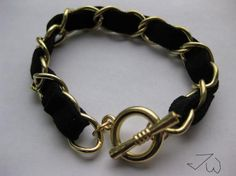 Simple braided leather and gold bracelet. Love it for its versatility.