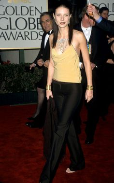 """The actress turned heads when she turned herself into a brunette for the 1999 drama """"Bounce"""" (which co-starred her on-again/off-again beau Ben Affleck). She also created some buzz when she showed up at the 2000 Golden Globes wearing pants. But if anyone could make the casual look seem edgy and elegant all it once, it's Gwyneth! (1/23/2000)"""