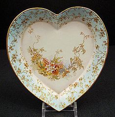 Antique ~ Royal Doulton ~ Burslem Heart Shaped Dish ~ Porcelain is fine bone china ~ The dish is made in the shape of a heart ~ The ground color shades from powderblue to pale pink ~ It is decorated with a transfer of tiny flowers and gilded vines ~ Swirling across the procelain ~ The border of the dish has a fine gilded pattern  of vines and flowers ~ There is gold trim around the rim Produced in England by Doulton Burslem ~ Circa 1890's