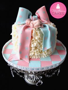Gender reveal cake! This is super cute!!! well minus the creepy baby on the top, gross.