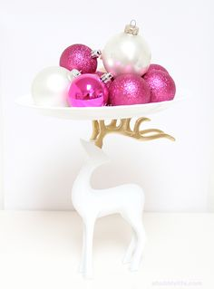 DIY Holiday Reindeer Cake Stand. You Need: Reindeer, Plate, Glue- liquid nails, Gold spray paint. Glue the plate to top of antlers, let dry and cure for at least 24 hours before using.