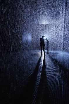 """The Rain Room, opening at London's Barbican Center on Oct. 4, is """"a 100 square metre field of falling water for visitors to walk through and experience how it might feel to control the rain."""" It was conceived by experimental art group Random International."""
