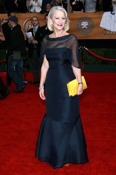 Helen Mirren Style Highs ~ Love the ocher satin envelope purse as the accessory for this navy blue column dress with sheer drape on the bodice
